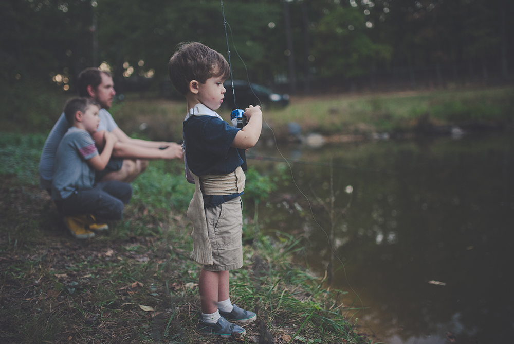 A young boy angling