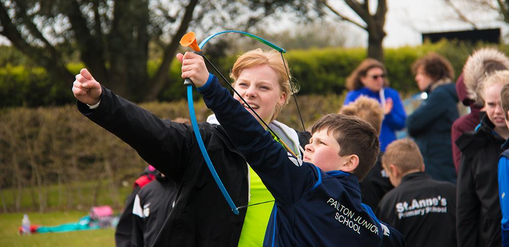 Female archery coach coaching