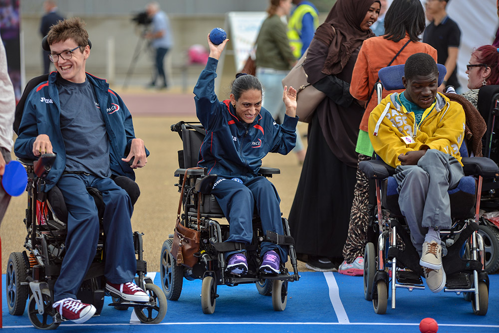 A group of young people playing Boccia