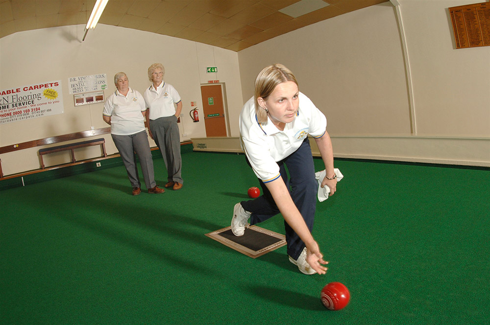 A lady playing bowls