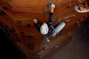 A boy climbing on a climbing wall