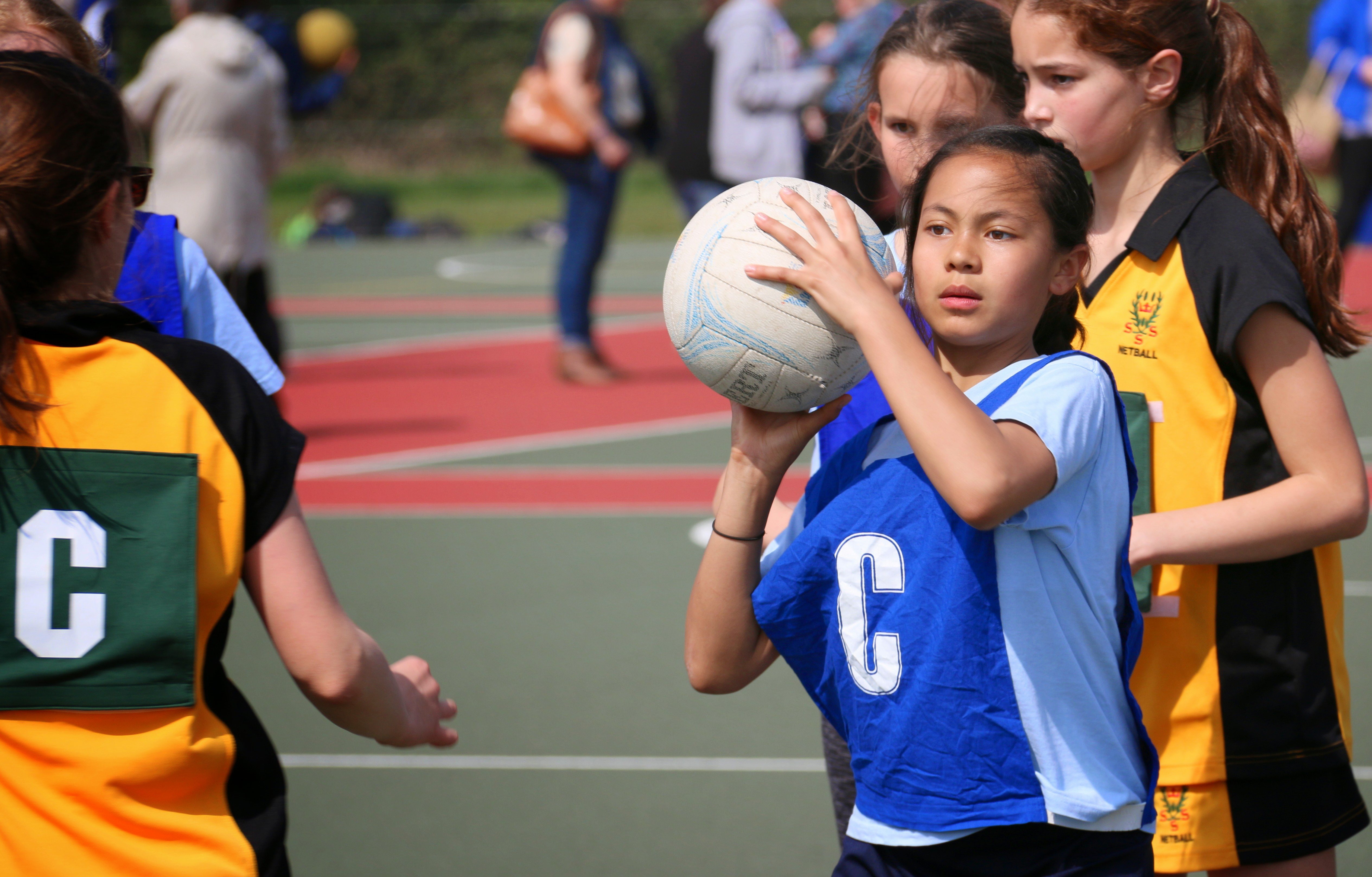 Primary Schools - Girl playing Netball