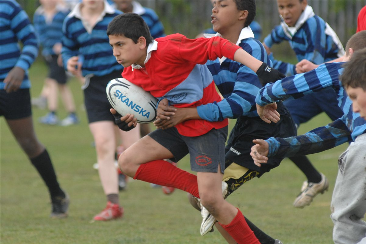 Boy playing rugby union