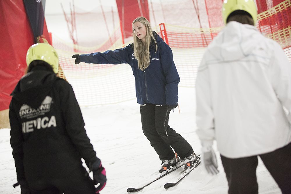 Skiers and snowboarders at SnoZone in Milton Keynes