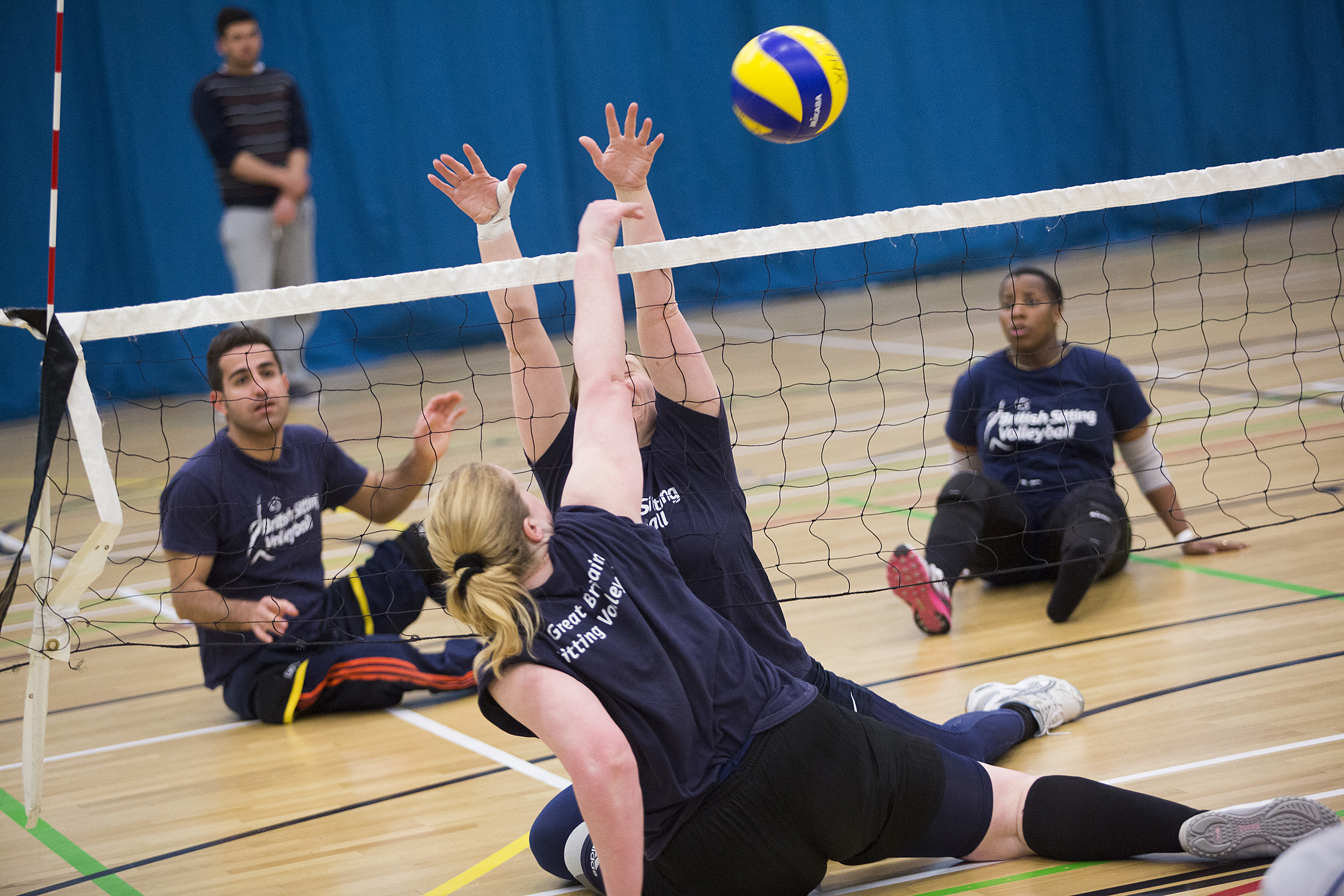 People playing sitting volley ball