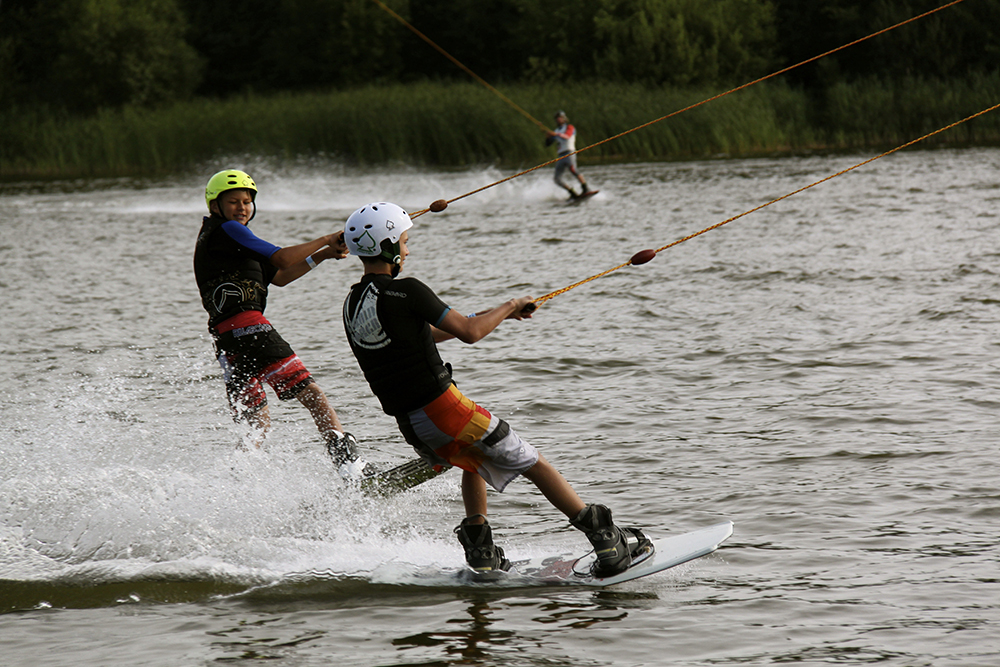 Two boys wakeboarding