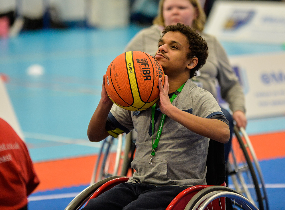 boy playing wheelchair basketball