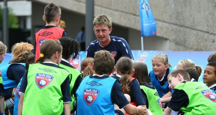 Coach Core - Man coaching children football