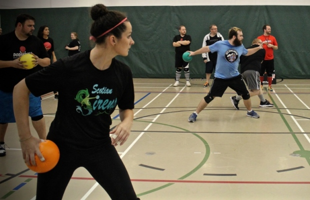 A young lady about to throw a dodgeball